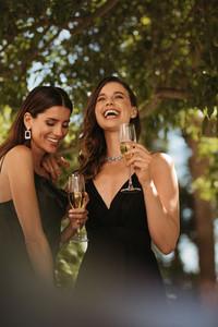 High society women enjoying at a celebration event