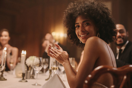Beautiful woman with friends at dinner party