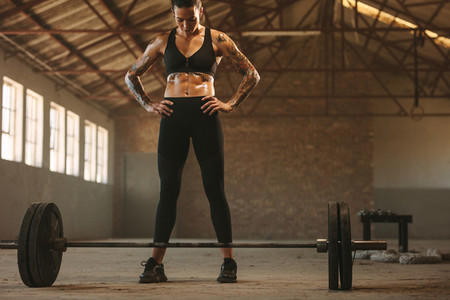 Fit woman working out with barbell