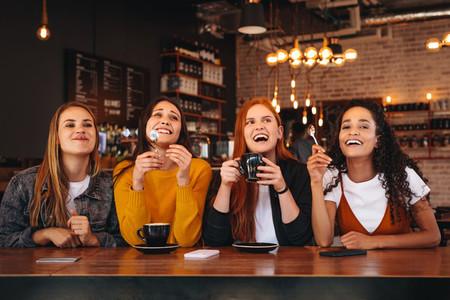 Female friends enjoying at a coffee shop