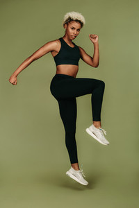 Portrait of woman athlete doing fitness exercise