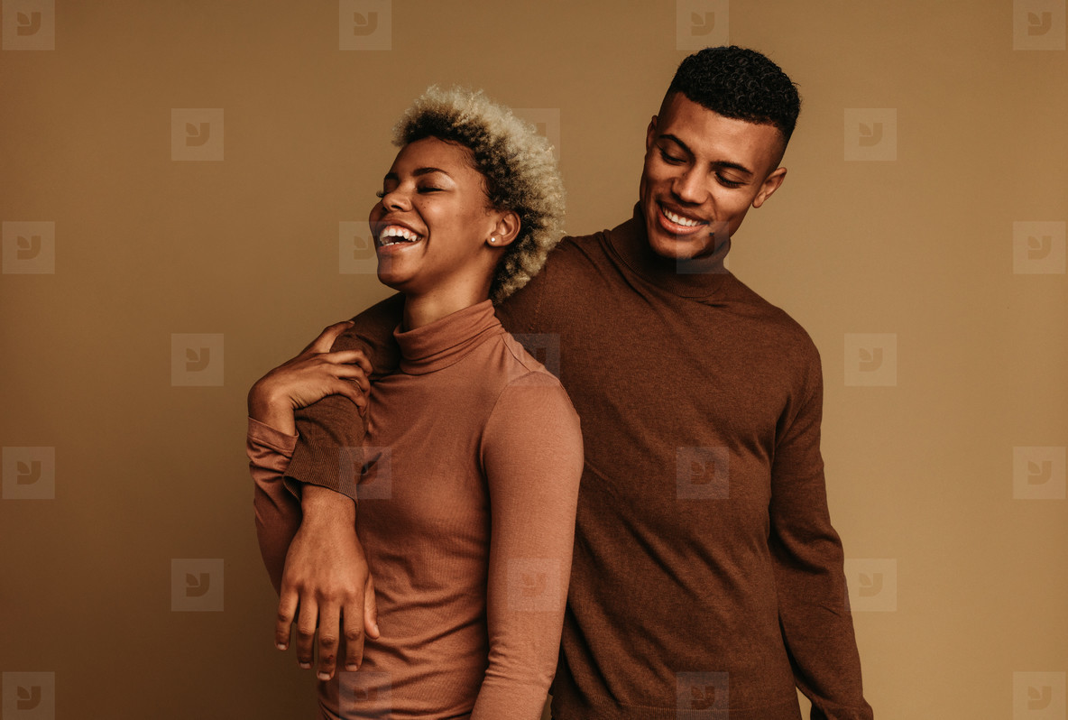 Smiling african american man and woman standing together