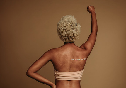 Rear view of a woman protesting