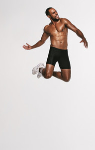 Fit man jumping in air during workout