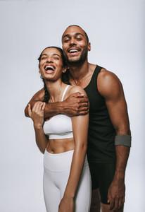 Monochrome portrait of laughing fit couple