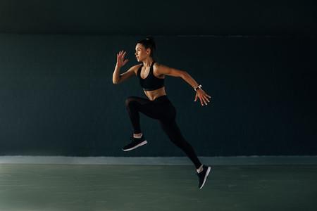 Sportswoman jumping in gym