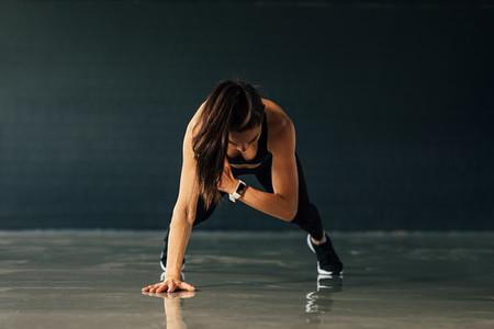Young muscular woman doing push
