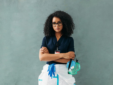 Serious nurse with arms crossed