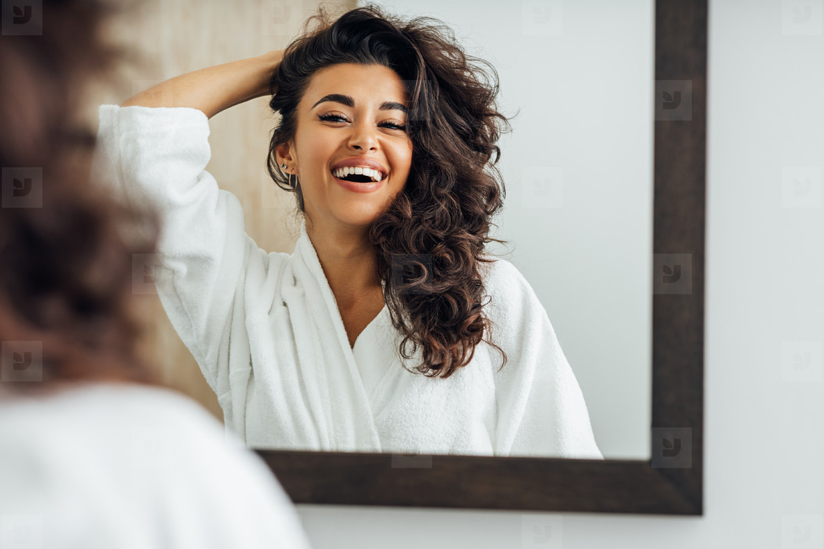 Happy woman in bathroom