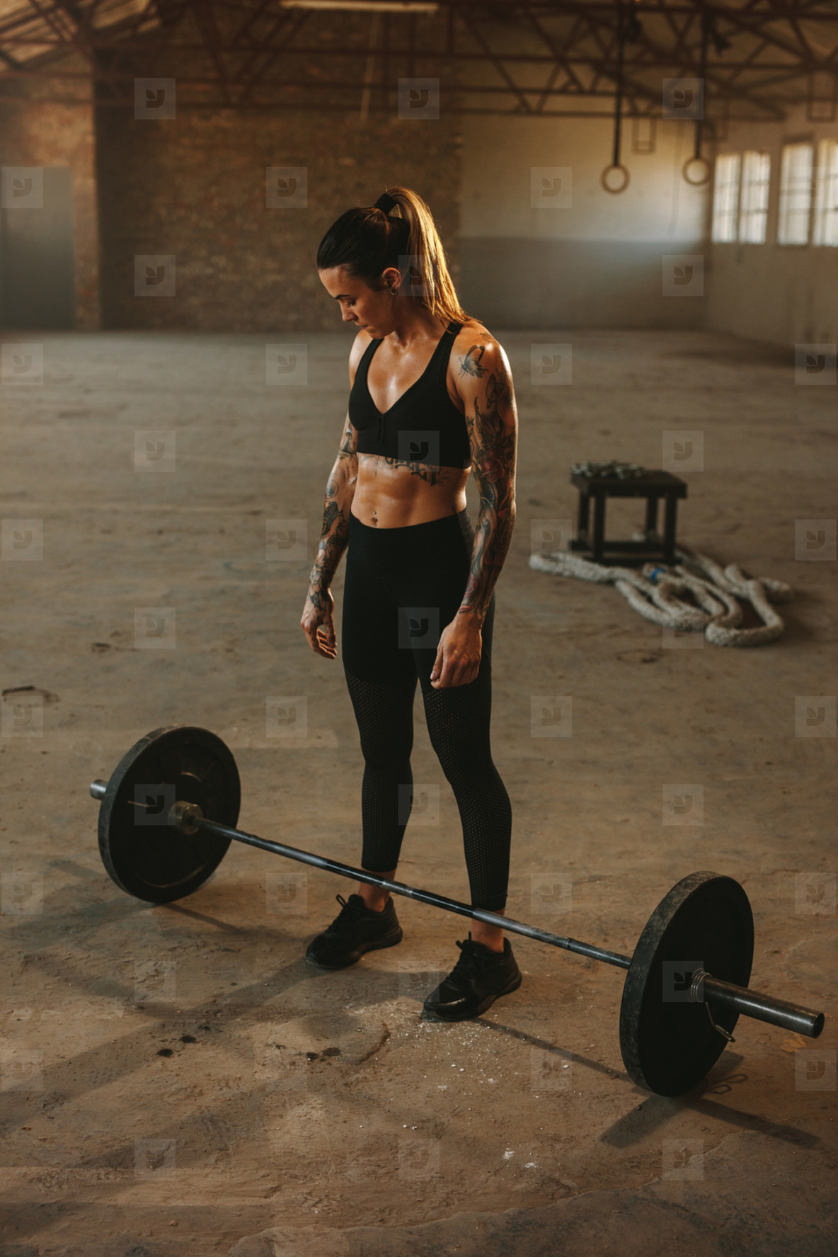 Woman ready to lift barbell