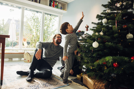 Small family together at home during Christmas