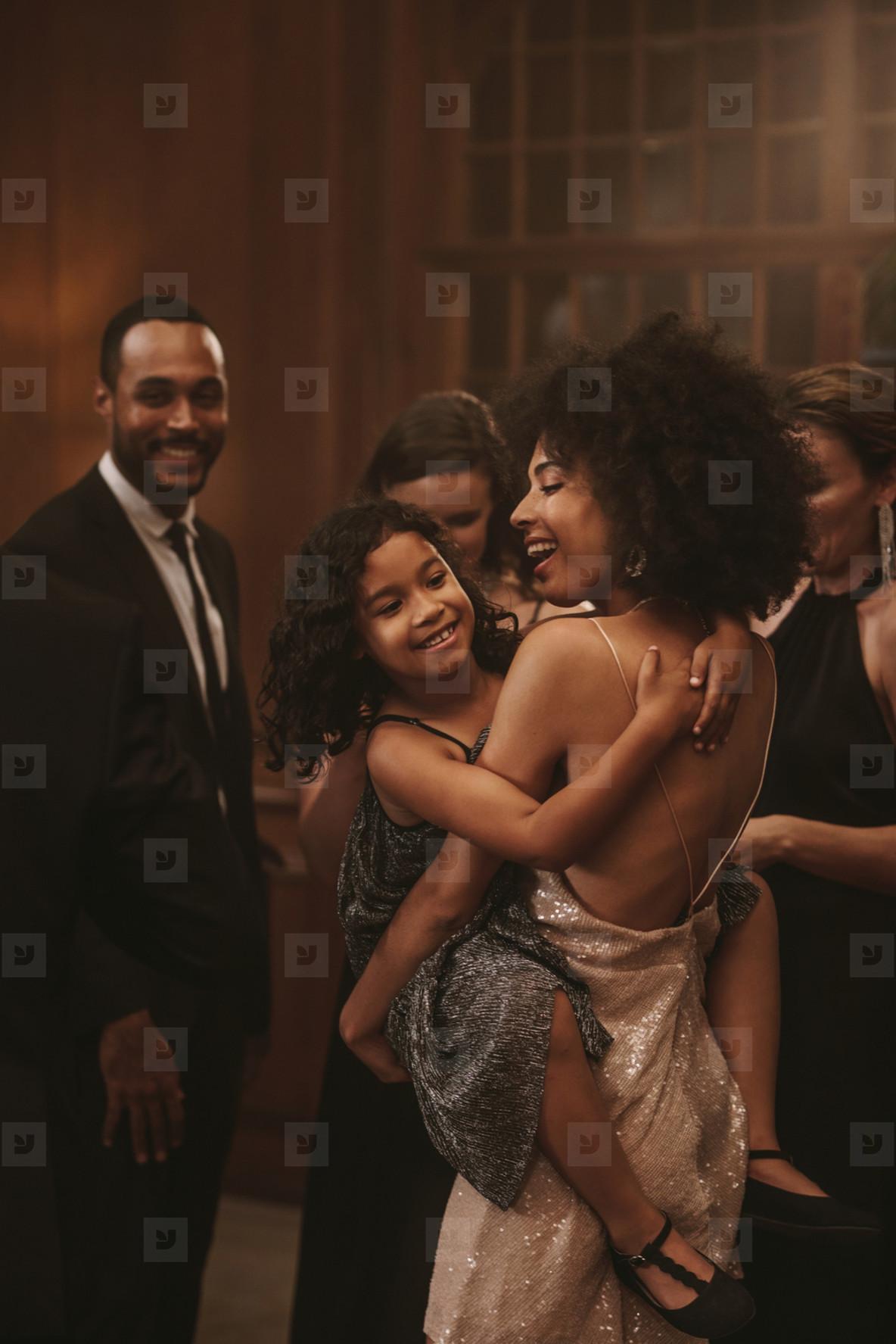 Woman dancing with her cute girl at gala night