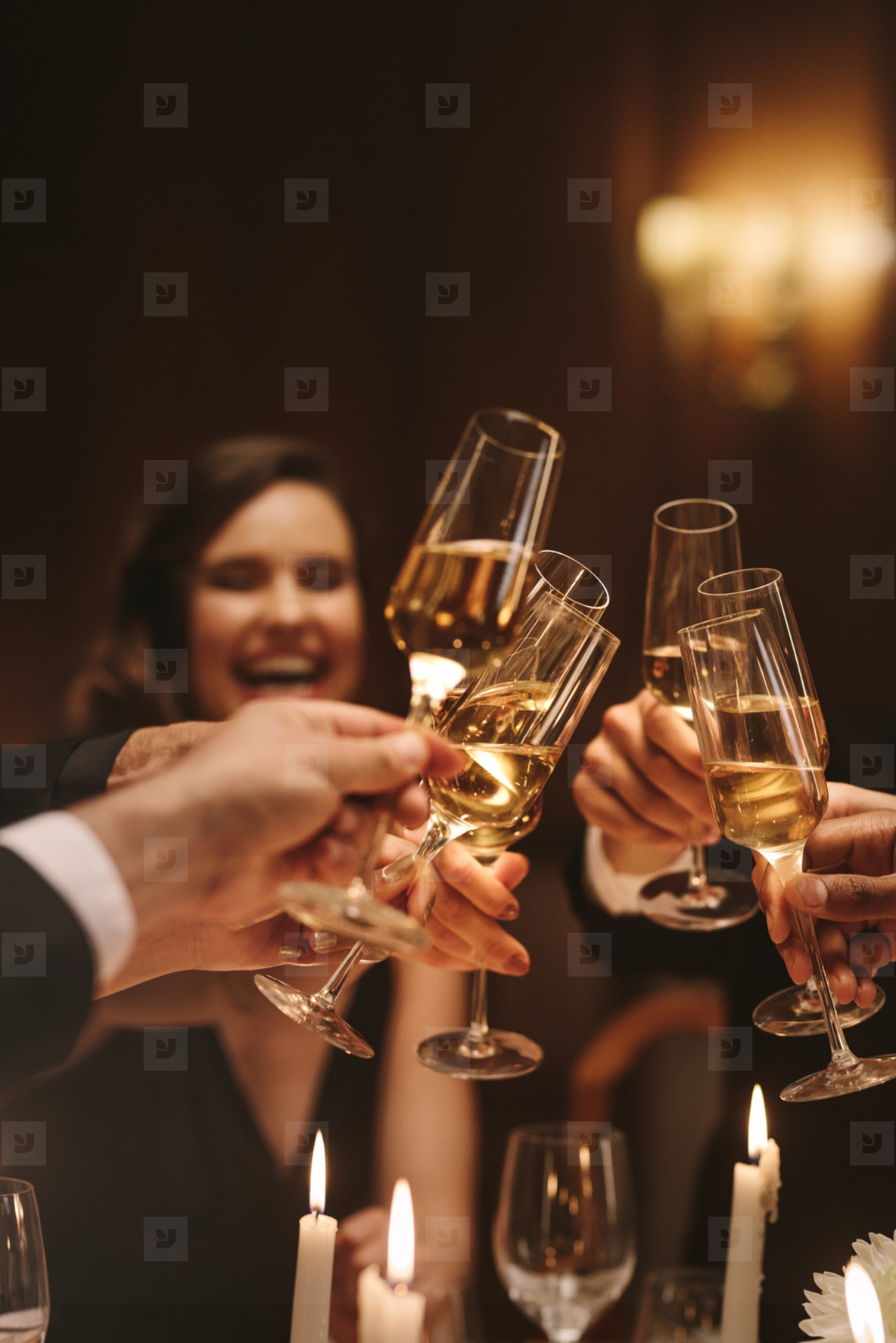 Group of friends having drinks at gala night