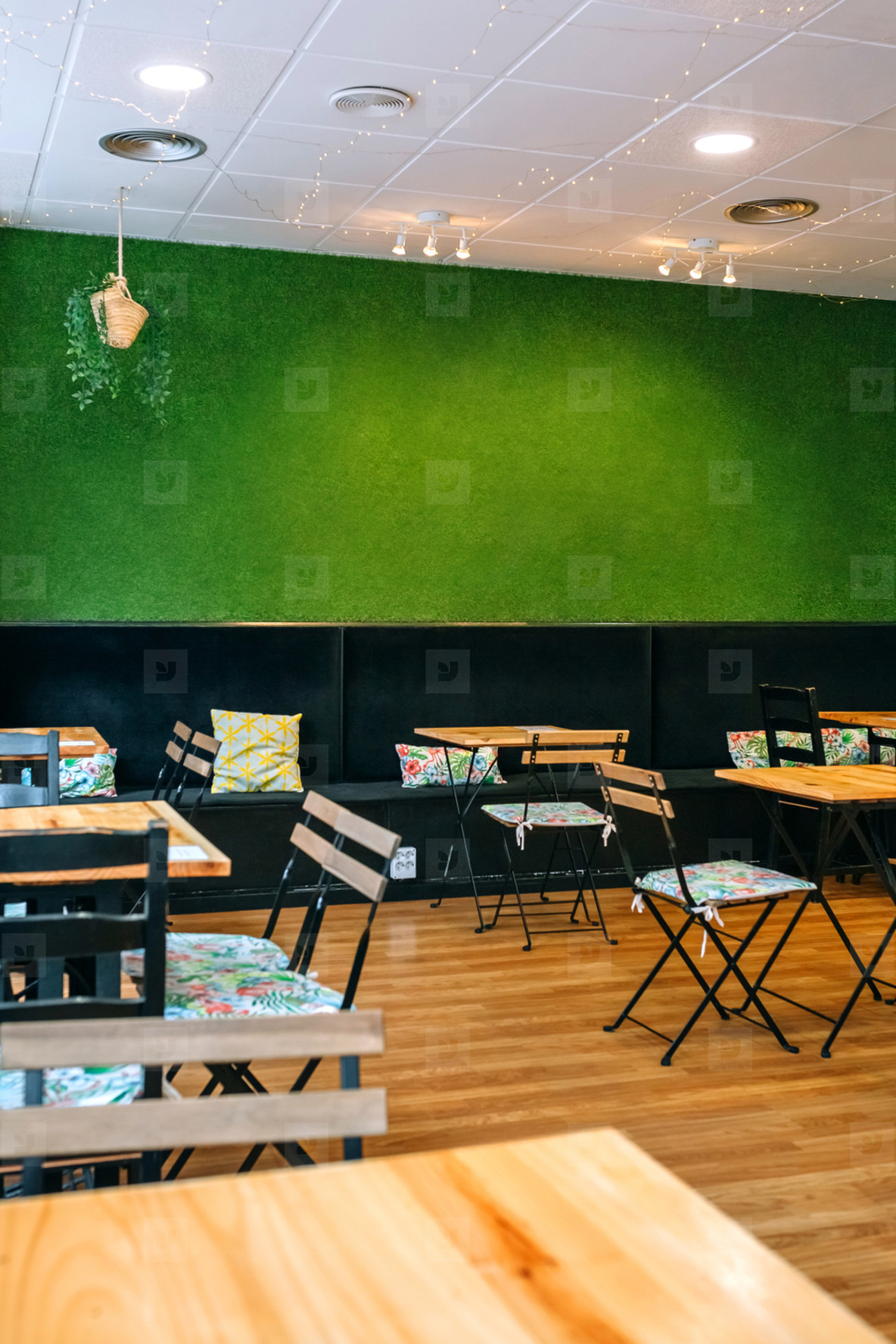 Empty coffee shop with grass wall