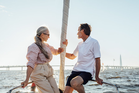 Elderly people sitting on yacht