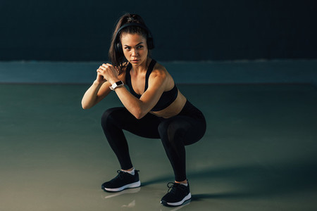 Young athletic woman doing sit