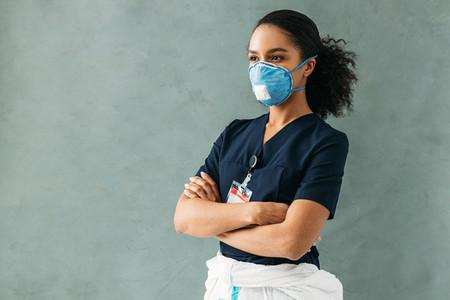 Female nurse wearing a mask