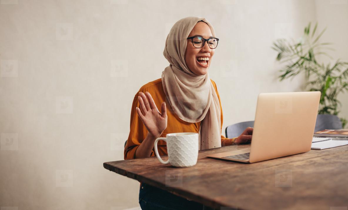 Muslim woman at home having a zoom meeting call