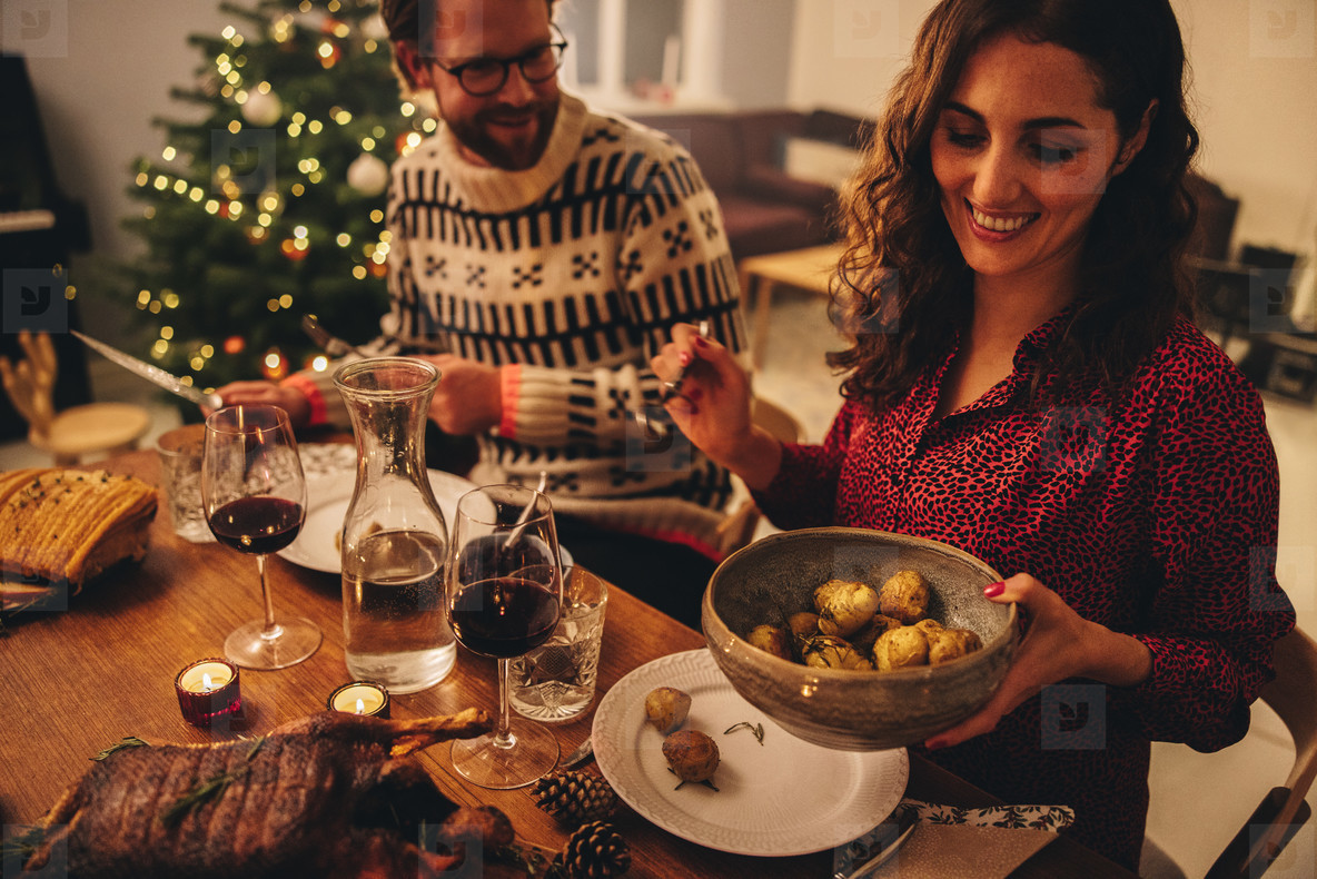 Couple enjoying Christmas dinner at home