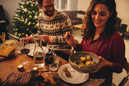 Couple enjoying Christmas dinner at home