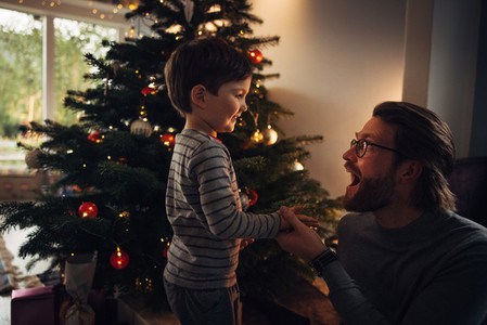 Father and son enjoying at home on Christmas eve