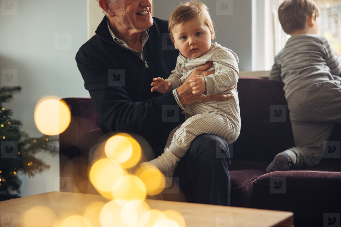 Kids with grandparents at home during Christmas