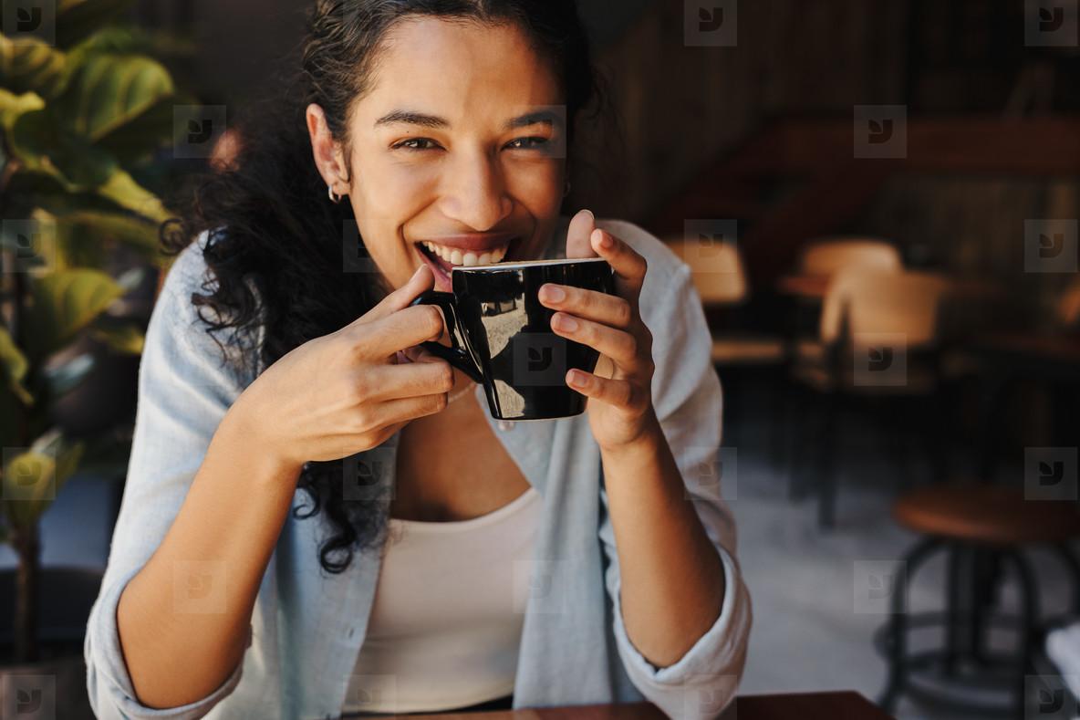 Beautiful woman enjoying a cup of coffee