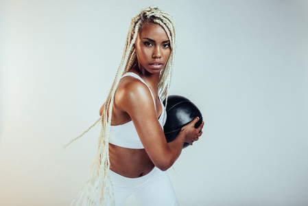 Portrait of fitness woman with medicine ball