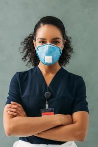 Confident nurse wearing mask