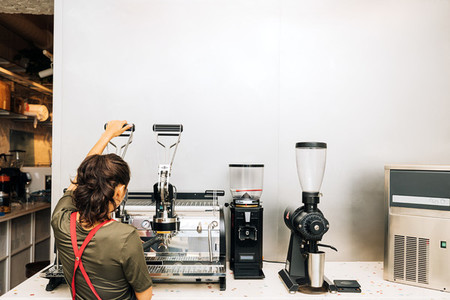 Rear view of barista