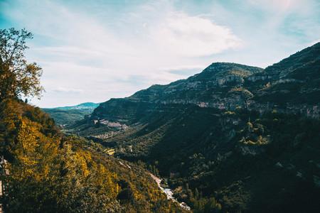 Imposing landscape with a steep mountain range of Cingles de Bert