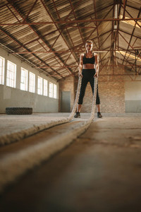 Woman about to start battling rope workout
