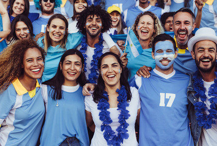 Group of Argentinian soccer fans in stadium