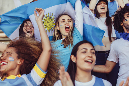 Females from Argentina cheering in fan zone