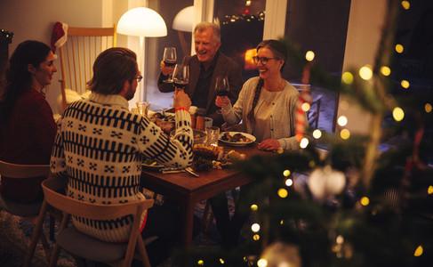 Family enjoying Christmas dinner with drinks