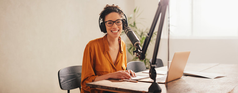 Woman recording podcast at home