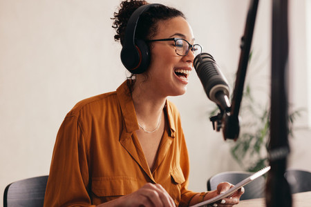 Woman enjoying podcasting from home