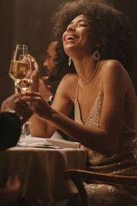 Smiling woman enjoying at dinner party