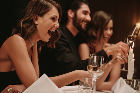 Woman enjoying at a dinner party with friends