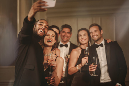 Friends taking selfie at new years party