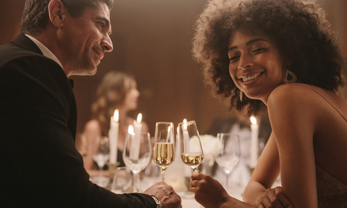 Beautiful couple at new years dinner party