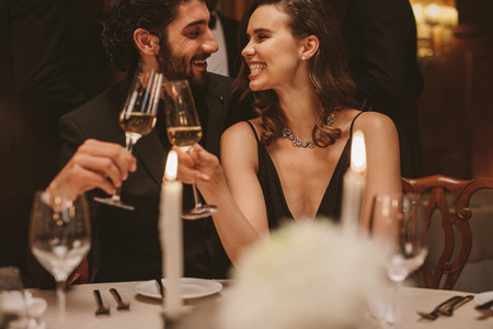 Romantic couple at a gala dinner party