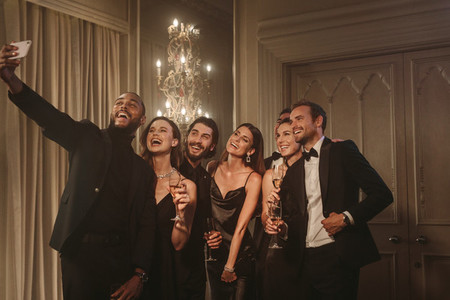 Group of people taking a selfie at party