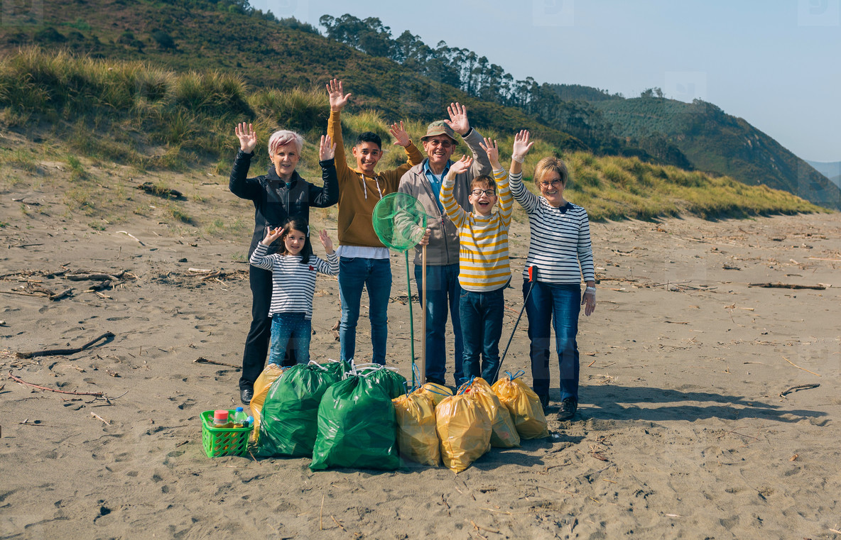 Volunteers posing after cleaning the beach