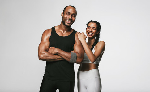 Monochrome fitness portrait of fit couple