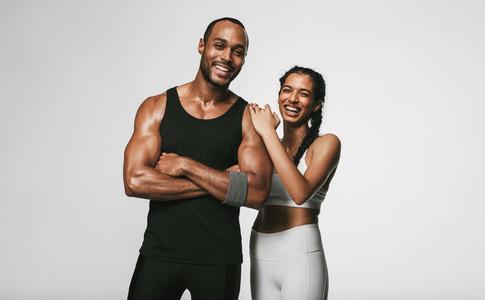 Monochrome fitness portrait of fit couple