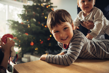 Kids having fun with family during Christmas