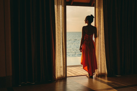 Woman on holiday at a luxury overwater villa