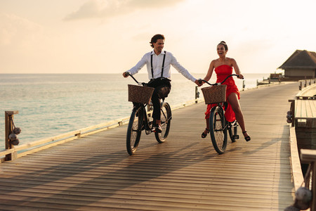 Couple enjoying a bicycle ride on a holiday