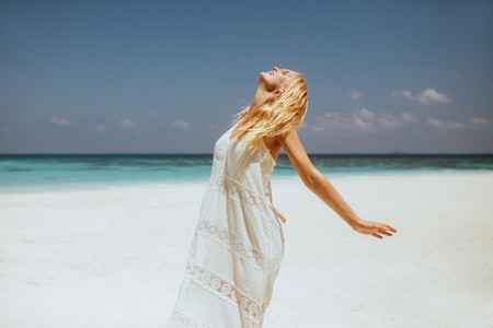 Portrait of a carefree woman on beach
